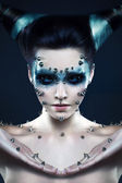 Demon girl with spikes on the face and body — Stok fotoğraf