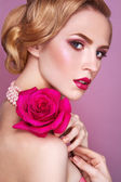 Lady with pink rose. — Stock Photo