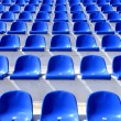 Blue plastic chairs on a stadium tribune — Stock Photo