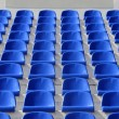 Stock Photo: Sector of stadium with blue armchairs with place for l
