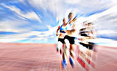 Young female athletes competing in the race — Stock Photo