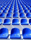 Blue plastic chairs on a stadium tribune — Stock Photo