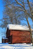 Old red log cabins — Stok fotoğraf