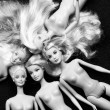 Stock Photo: Barbie dolls on black