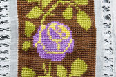 Knitted tablecloth with rose — Stok fotoğraf