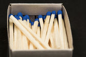 Unused matches with blue head screw in the box — Stock Photo