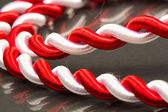 White and red cord with dark background — Stock Photo