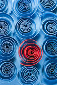 Picture of blue and red paper spirals on paper background — Stock Photo