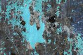 Metallic surface with peeled paint and inverted colors — Stock Photo