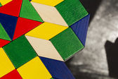 Colorful wooden pieces for tangram technique — Stock Photo