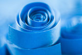 Blue paper spiral on paper background — Stock Photo