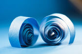 Blue paper spirals on paper background — Stock Photo