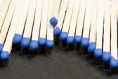 Unused matches with blue head screw — Stock Photo