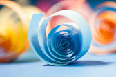 Macro, abstract, background picture of colored paper spirals on paper background — Stock Photo