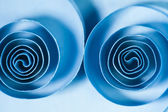 Macro, abstract, background picture of blue paper spirals on paper background — Stock Photo