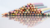 Group of sharp colored pencils with white background and reflexions — Stock Photo