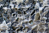 Old wall texture with peeled mortar and the materials inside with inverted colors — Stock Photo