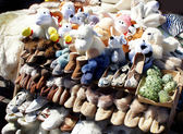Trade in warm slippers and soft toys — Stock Photo