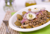 Salad with tuna, mushrooms and green olives — Stock Photo