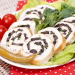 Chicken roll with black olives — Stock Photo