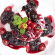 Creamy Panna Cotta with fresh berries and mint leaves — Stock Photo