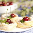 Cakes from flaky pastry with cherry — Stok fotoğraf