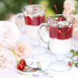 Dessert of ice-cream, bananas and cherries in a glass — Stock Photo