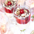 Dessert with a cherry in glass cups — Stock Photo