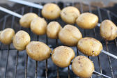 Young potatoes on the grill — Stock Photo