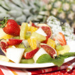 Fruit salad on the background of fresh pineapple — Stock Photo