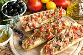 Hot sandwiches with cheese, meat and vegetables — Stock Photo