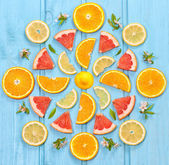 Mix of colorful citrus fruit on blue background — Stock Photo