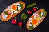 Fresh sandwiches with egg, radish, feta cheese and spinach  — Stock Photo