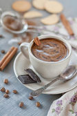 Cup of coffee with cinnamon and chocolate — Stock Photo