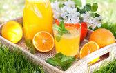Homemade lemonade from oranges and lemon — Stock Photo