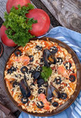 Pizza with seafood and black olives — Stock Photo