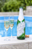 A bottle of champagne and glasses — Stock Photo