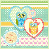Valentine's day greeting card with cute owls — Stockvektor