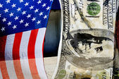 A flag and one hundred dollars. — Stock Photo