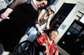 The elderly woman in invalid carriage. — Stock Photo