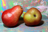 Red pear and green pear on the painted background. — Stock Photo