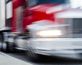 Fast moving semi — Stock Photo