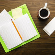 Notebook, papers and coffee — Stock Photo
