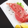 Raw steak on a plate — Stock Photo #38827841