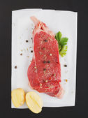 Raw steak on a plate — Stock Photo