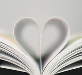 Heart shaped from book's pages — Stock Photo