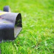 Grass mower mowing the grass — Stock Photo #50505187