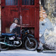 Stockfoto: General view of mural 'Boy on Bike