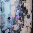 "Foto Stock: Street Mural tittle ""boy play basketball with women"""