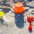 Toys for childrens sandboxes against the sea and the beach — Stock Photo